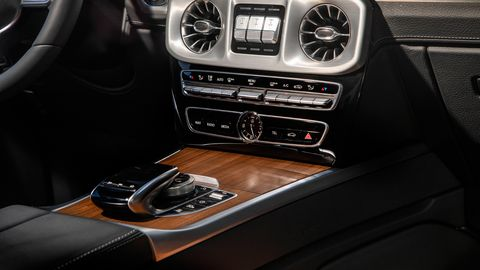 The 2019 Mercedes-Benz G550 comes stocked with wood, leather and brushed metal inside.