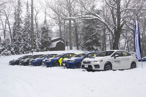 The cars and atmosphere on frozen over Dollar Lake at the Subaru Winter Experience