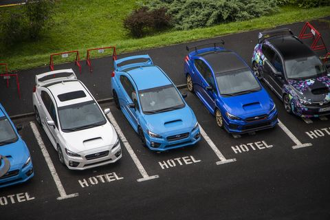 The Subaru WRX STI Type RA (dark blue) parked next to its STI brothers.