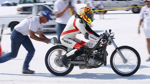 Burt Crow gets a push as he leaves on a 93.472 mph run.
