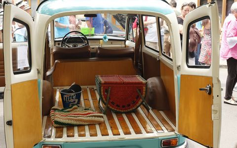 The woman who owned this beautiful '67 Volvo Duett decorated it with parasols and matching picnic accessories.