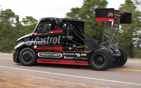 The Cascadia Pikes Peak Special '08 Freightliner climbs the mountain in a cloud of diesel smoke.