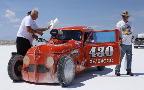 The crew of the Great Pumpkin 1947 Crosley prepare their car for action. It went 141.419 mph.