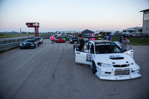 Drivers had to race against the setting sun to get their laps in on Autobahn's 3.56-mile full course Saturday evening.