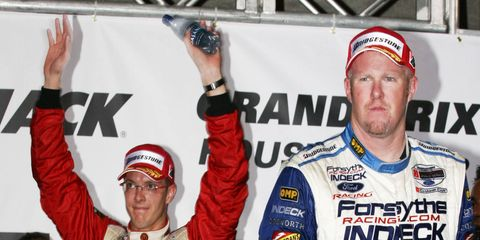 Sebastien Bourdais, left, and Paul Tracy were never best buddies when they battled on the track in Champ Car.