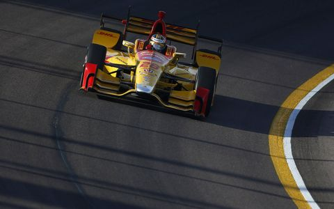 Friday's practice at Phoenix was interrupted by a sandstorm, as later Helio Castroneves shattered the lap record he set a year ago on the 1.022-mile oval in Friday night's qualifying for the Desert Diamond West Valley Phoenix Grand Prix.