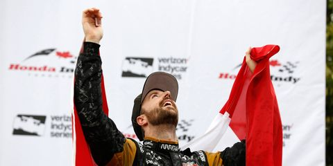 James Hinchcliffe celebrates his third-place finish on the podium in Canada on Sunday.
