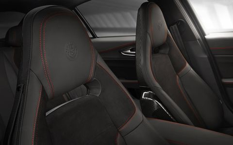 The interior of the 2017 Alfa Romeo Giulia Quadrifoglio is clean and simple with suede and carbon fiber throughout.