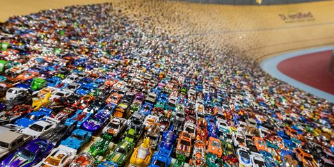 To create our temporary display, we hand-stuck 8,200 Hot Wheels cars to the banked track at the Lexus Velodrome.