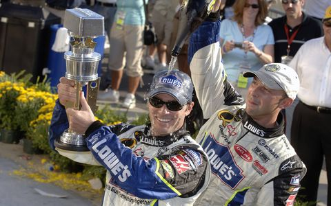 Crew chief Chad Knaus, right, celebrates a Jimmie Johnson victory at Indianapolis in 2006.