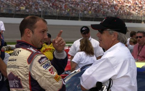 Chad Knaus, left, and team boss Rick Hendrick chat at Michigan International Speedway in 2004.
