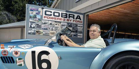 Historic Motor Sports Association president Cris Vandagriff -- you'd smile too if you had his job.
