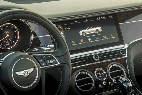 """The 2019 Bentley Continental GT Convertible """"Bentley Rotating Display"""" is a three-sided block where the owner can choose between 12.3-inch touchscreen or three analog gauges or, when the car isn't running, a simple block of veneer wood."""
