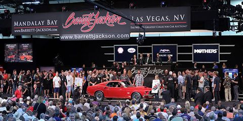 Motor vehicle, Crowd, People, Logo, Display device, Stage equipment, Audience, Public event, Advertising, Luxury vehicle,