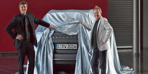 Borgward executives pose with the company's new SUV model, which is set to be revealed at the Frankfurt motor show later this fall.