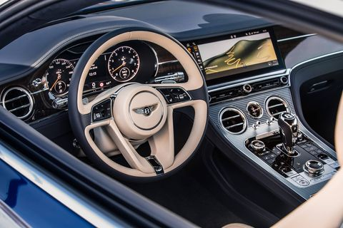 The interior of the 2019 Bentley Continental GT is as plush -- and as silent -- as you'd expect in one of the marque's grand tourers. To make it even more relaxing, the push of a button makes the central infotainment screen disappear.