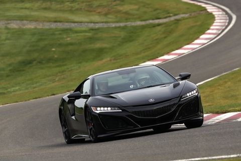 The 2019 Acura NSX in black, lapping its own personal Nurburgring in Northern Japan. It's called The Winding Course.
