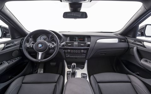 The 2017 BMW X4 M40i's interior looks mostly like a 3-Series with stiff seats and lots of plastic buttons.