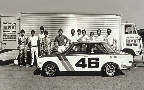 A BRE Datsun 510 with the team's Hino transporter (its diesel swapped for a Cadillac V8).