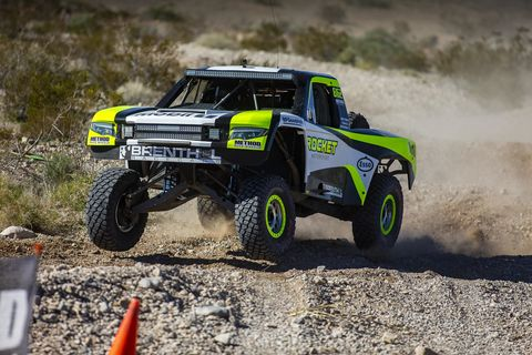 The Rocket Mototrsports Trophy Truck, driven by Jenson Button, among others, bashes its way through the desert during the last Mint 400. Those following the recent Mint 400 know that Jenson Button has formed a desert racing team that includes Chris Buncombe, former Aston Martin LMP driver, and Maz Fawaz, managing director for Singer Vehicle Design's Dynamic and Lightweighting Study project. It's been ten years since Jenson's Formula One championship and he's going to be celebrating that milestone with the very same livery on this team's Trophy Truck, which they're planning to use in the Baja 1000 later this year, as well as the Reno to Vegas rally in August.