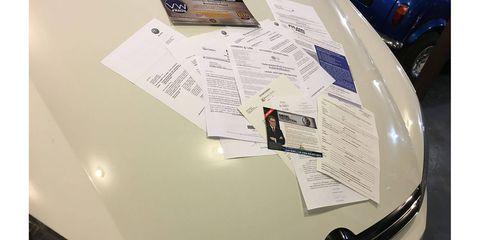 Here's the heap of correspondence on the hood of Perku's Jetta wagon.