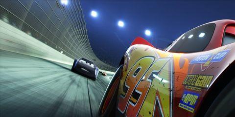 High-tech young racer car Jackson Storm chasing down Lightning McQueen