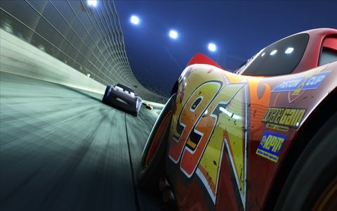High-tech young racer car Jackson Storm chasing down Lightning McQueen