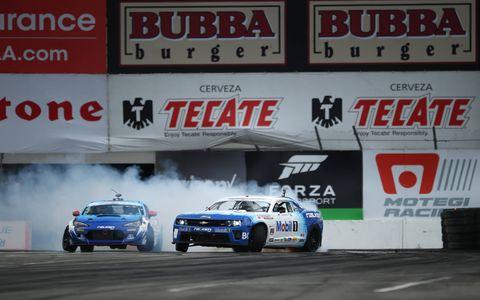 """Tyler McQuarrie's Camaro leads Dai """"Drift Or Die"""" Yoshihara's Subaru BRZ."""