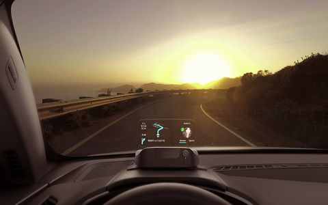 The Navdy head-up display is visible in direct sunlight.