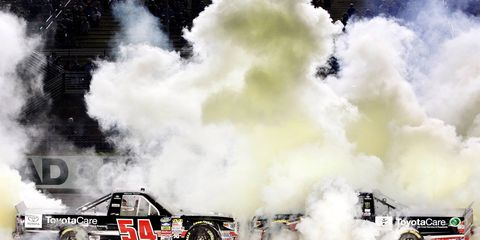 Darrell Wallace Jr. (54) and boss Kyle Busch (51) celebrate Wallace's win at Homestead on Friday night.
