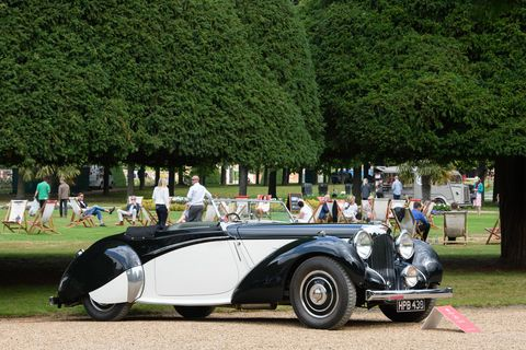 """The three-day-long Concours of Elegance is one of the world's best gatherings of classic - and some modern - automobiles. This year it was held again in the Fountain Gardens of Hampton Court Palace, a short drive from London. Sixty select cars park inside Hampton Court while """"nearly 1000"""" amass outside, the latter brought by car clubs across the UK. Here is a Lagonda."""