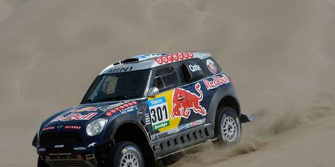 Nasser Al-Attiyah holds the lead at the halfway point of the Dakar Rally.