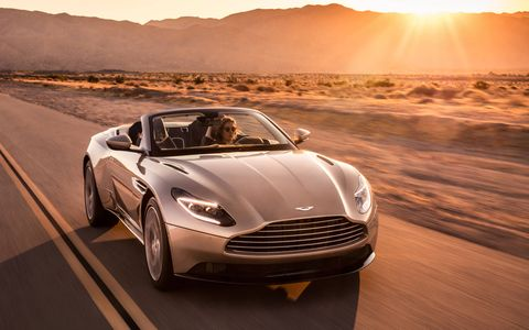 The Aston Martin DB11 Volante is the most recent in a long line of drop-tops based on the company's grand tourers. This new convertible gets a 503 hp, 513 lb-ft V8 from the automaker's technical partner AMG.