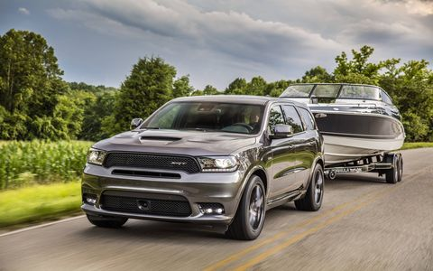 2018 Dodge Durango SRT showing off its ability to tow a boat
