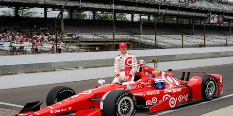 Scott Dixon led a Chevrolet assault at Indianapolis by winning the pole for the 99th Indianapolis 500.