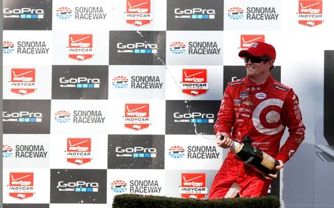 Scott Dixon unleashes champagne after winning in Sonoma.