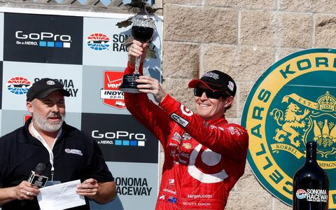 Scott Dixon hoists his wine glass trophy after his victory in Sonoma.