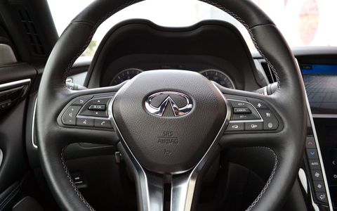 The interior is luxurious. Everything feels lush and expensive, and the double-screen infotainment system works well.