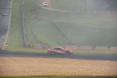 Managing Editor Robin Warner drifting a Ford Mustang prepared by Vore at Road Atlanta