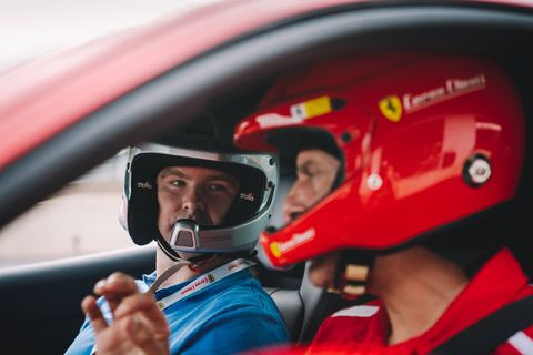 The classroom and atmosphere around Monticello Motor Club at Corso Pilota Sport. In the driver's seat, Italian instructor Lorenzo Case giving Robin Warner some tips before a stint in the car