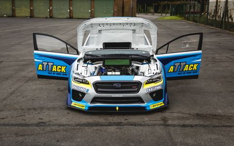 Subaru and Mark Higgins set a new lap record at the Isle of Man TT.