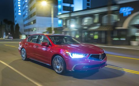 It's time for the Acura RLX's mid-cycle facelift - look at the new front and rear clips, hood, side sills and wheels. Inside is a new premium sport seat. Hit the right buttons and you get the new Traffic Jam Assist, which uses cruise control and lane keep assist to drive the car in stop-n-go traffic.
