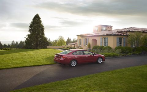 The base 2.0i model gains standard cruise control and a touch-screen infotainment system, and all trims now have a standard Rear Vision Camera and one-touch lane changer feature for the turn signals.