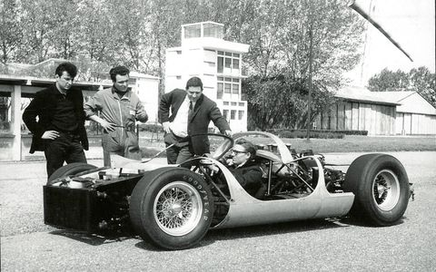 Enzo Ferrari standing next to Tom Meade's creation. Now that's a picture.