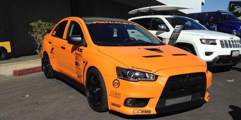 A hot orange Mitsubishi Evo.