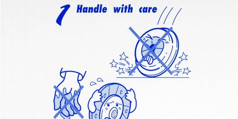 A pained pressure plate crashes to the floor, while a terrified clutch disc flees a dirty hand.
