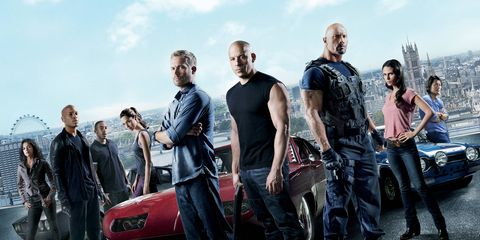 """The cast of """"Fast and Furious 6"""" gathers around a Charger Daytona like moths to a flame."""