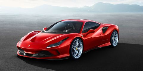The Ferrari F8 Tributo, successor to the 488 GTB, is powered by a turbocharged 3.9-liter V8 producing 710 hp. Styling elements like the quad taillights and louvered rear windscreen pay tribute to past Ferrari greats.