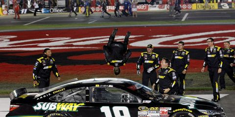 Carl Edwards won his first race of the season and punched his ticket to NASCAR's postseason.
