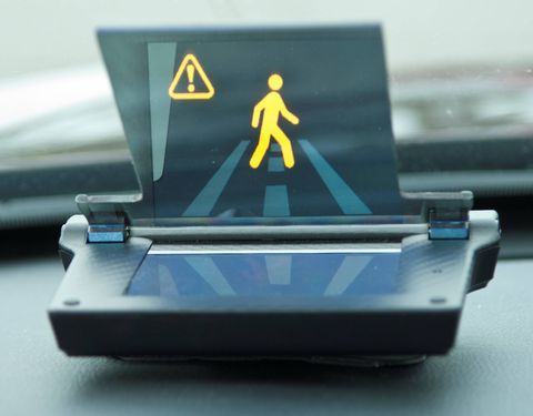 The Honda Smart Intersection is four cameras and a DSRC setup attached on a traffic light communicating to cars with a purpose built head-up display to warn drivers of potential hazards that are out of sight.